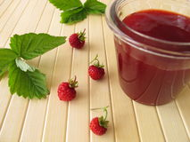 Jar of am with wild strawberries Royalty Free Stock Images