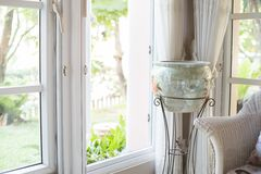 The Jar Beside Window. The beautiful and classic style jar Stock Image