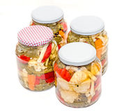Free Jar With Pickles Containing Cauliflower, Cucumber, Red Pepper Stock Image - 79615871