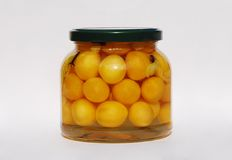 Jar of Yellow Cherry Grappa Preserve Royalty Free Stock Images