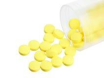Jar with yellow pills Stock Photos