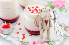 A Jar of Yoghurt with Raspberry Jam and a Teddy Bear Toy Leaning Over It Royalty Free Stock Image
