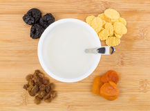 Jar of yogurt, heap dried fruits and corn flakes Royalty Free Stock Photo