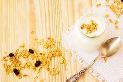 A jar of yogurt with honey glazed oatmeal, granola Royalty Free Stock Images