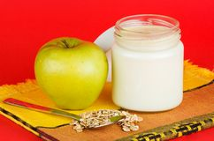 Jar with yogurt isolated on red background Royalty Free Stock Photos