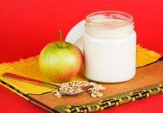 Jar with yogurt isolated on red background Stock Image