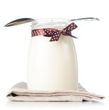 Jar of yogurt with a polka dot ribbon Stock Image