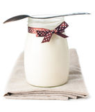 Jar of yogurt with a polka dot ribbon Stock Images