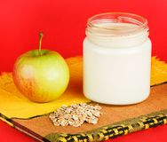Jar with yogurt  on red background Royalty Free Stock Photography