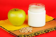Jar with yogurt  on red background Stock Photography