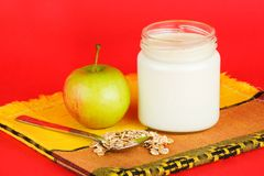 Jar with yogurt  on red background Royalty Free Stock Image