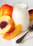 Jar of yogurt and sliced nectarines Royalty Free Stock Photo