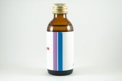Jarabe de la botella de la medicina Foto de archivo libre de regalías