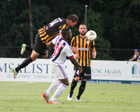 Jarad Van Schaik, Midfielder, Charleston Battery. Charleston Battery midfielder Jarad Van Schaik #14 tries to head the ball against West Bromwich Albion's Victor Stock Photography