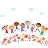 Jardín de flores con los niños Imagenes de archivo