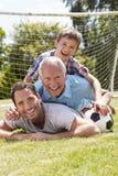 Jardín de With Football In del abuelo, del nieto y del padre Imágenes de archivo libres de regalías