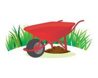 Jardín rojo de la carretilla Imagen de archivo libre de regalías