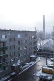 A jarda durante a queda de neve Imagens de Stock