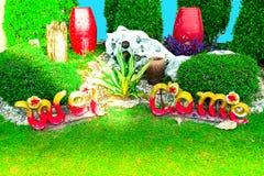 Jardim com mensagem bem-vinda imagens de stock royalty free
