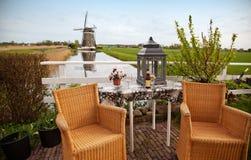 Jardim com moinho de vento Foto de Stock Royalty Free