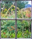 Jardim da casa de campo através de uma janela de faixa velha imagem de stock royalty free