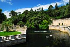 Jardin de la Fontaine in Nimes France. Park Jardin de la Fontaine in city of Nimes in southern France stock photo