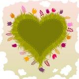 Jardin en forme de coeur avec des fleurs Images stock
