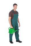 Jardineiro com lata molhando Fotografia de Stock Royalty Free