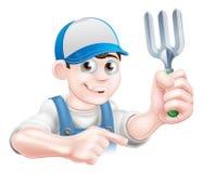 Jardinero Holding Fork de la historieta Foto de archivo libre de regalías