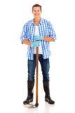 Jardinero que se coloca blanco Imagenes de archivo