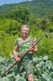 Jardinier avec la houe 7 Images libres de droits