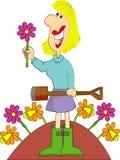 Jardinier féminin avec des fleurs Photo stock