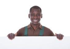 Jardinier Holding Bill Board Image stock