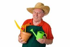 Jardinier supérieur retenant des outils de jardinage Photo libre de droits