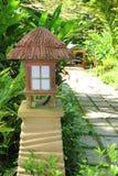 Jardín tropical con la lámpara Fotos de archivo libres de regalías