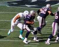 Jared Odrick renvoie Tom Brady Images stock