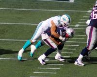 Jared Odrick sacks Tom Brady. Miami Dolphins Defensive lineman Jared Odrick (98) sacks New England Patriots quarterback Tom Brady (12) early in the first quarter Royalty Free Stock Images