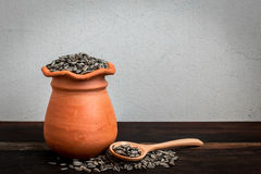 Jarful and Spoonful of rich sunflower seeds Royalty Free Stock Photo