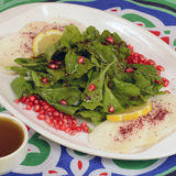 Jarjeer Salad (Arugula Salad). Arugula Salad with onion and lemon stock photo