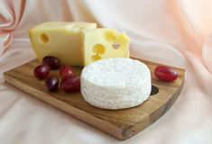 Jarlsberg Cheese with Camembert Cheese and grapes Royalty Free Stock Image