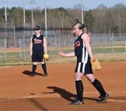 Jarra del beísbol con pelota blanda de la muchacha Imagen de archivo