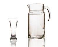 Jarra y vidrio con agua Imagen de archivo libre de regalías