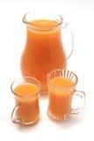 Jarra y vidrios con el zumo de naranja Imagen de archivo libre de regalías