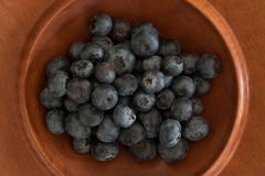 Jarrah bowl filled with blueberries Royalty Free Stock Photos
