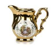 Jarro de la porcelana para la leche en un fondo blanco Imagen de archivo libre de regalías