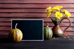 Jarro negro del tablero, de la calabaza y del cobre Foto de archivo libre de regalías