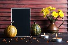 Jarro negro del tablero, de la calabaza y del cobre Foto de archivo