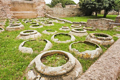 Jars in the ancient Roman archaeological site of Ostia Antica - Royalty Free Stock Photo