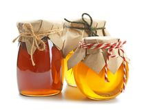 Jars with aromatic honey. On white background stock photography
