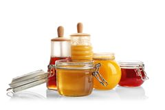 Jars with aromatic honey. On white background royalty free stock photos